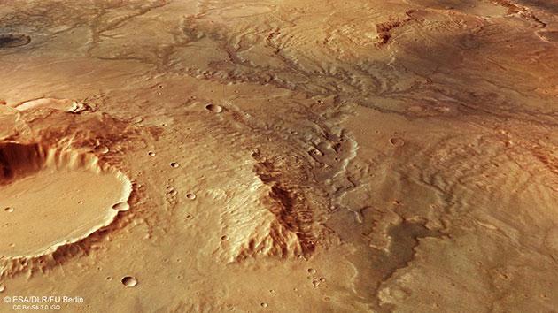 """Perspektivische Schrägansicht der der Flusstäler östlich des Huygens-Kraters durch """"Mars Express"""". Copyright: ESA/DLR/FU Berlin/ CC BY-SA 3.0 IGO"""