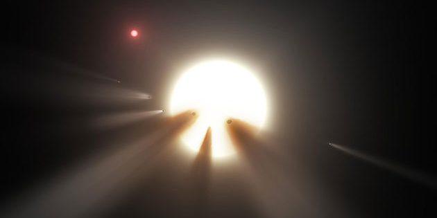 Künstlerische Darstellung von einen Stern abdunkelnden Kometen (Illu.). Copyright: NASA/JPL-Caltech