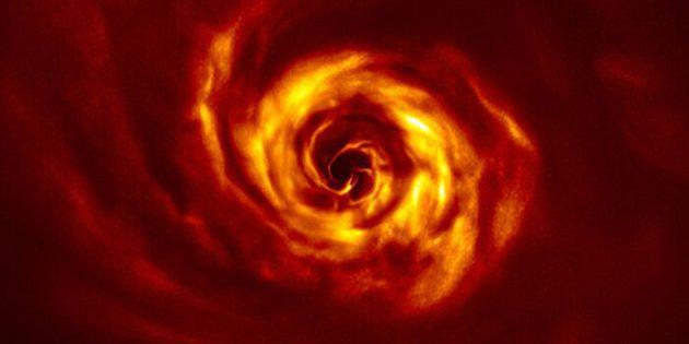 Teleskopaufnahme der Scheibe um den jungen Stern AB Aurigae, in der Astronomen Anzeichen einer Planetengeburt entdeckt haben. Copyright: ESO/Boccaletti et al.