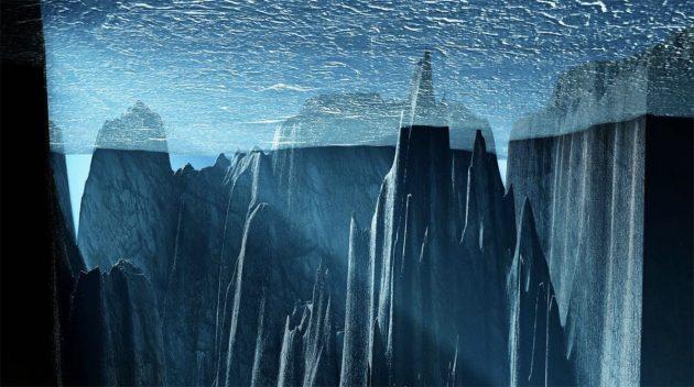 Künstlerische Darstellung der Perspektive aus dem inneren des glazialen Ozeans, mit Blick von unten Richtung Island und den Färöer-Inseln; im Vordergrund Jan Mayen, rechts Grönland. Von oben verengt ein Eispanzer die schmalen Durchlässe. In Wikrlichkeit sind diese Meerestiefen völlig lichtlos, und die Lichtstrahlen werden hier gezeigt, um den Meeresboden sichtbar darzustellen (Illu.). Copyright/Quelle: Martin Künsting / Alfred-Wegener-Institut